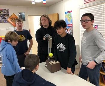 STEM students looking at equipment donated by Syracuse Plastics of North Carolina