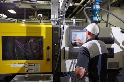 Plastic Components Inc. representative using scientific molding practices while producing high volume plastic parts.